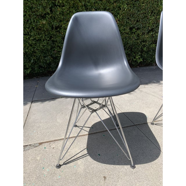 "Purchased new from DWR in 2009. Gently used condition. Some scratches on plastic and oxidation on chrome. Classic ""Eiffel..."