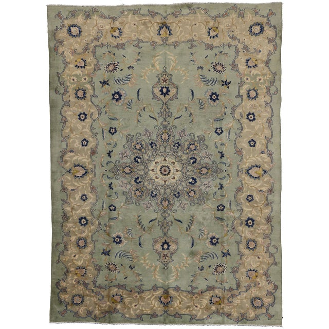 Vintage hand-knotted Persian Kashan carpet with a center floral medallion motif. Allover floral and vine scroll motifs...