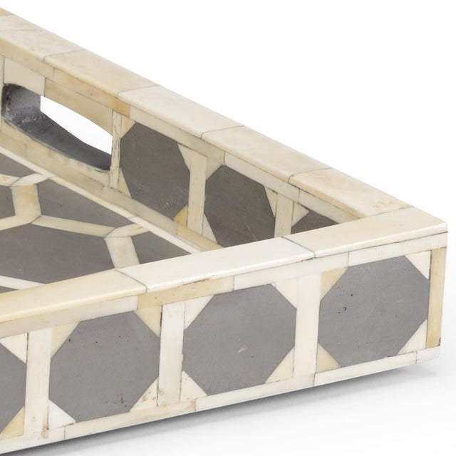 This is the Newton tray by Chelsea House Inc. The piece is made of wood, with white and gray bone inlay, featuring a...