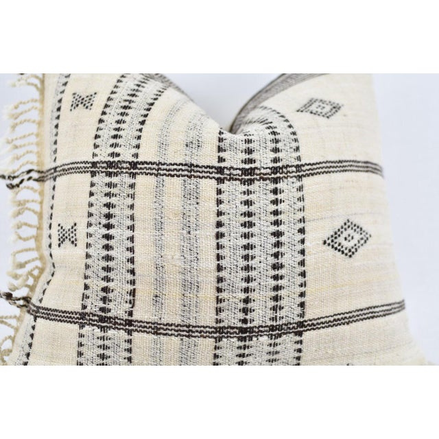 Pillow cover made from handwoven wool textile imported from India. It takes artisans 2 weeks to make one piece of blanket....