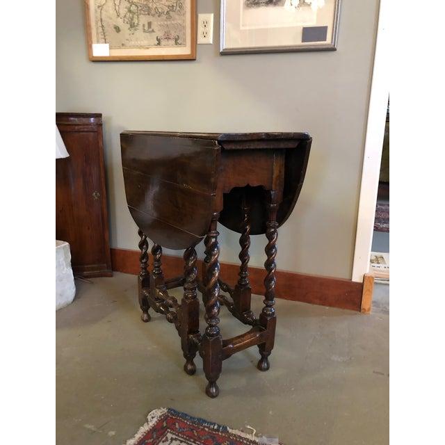 17th century circa 1670-1680 English barley twist gate leg table. Wonderful primitive qualities throughout with an...