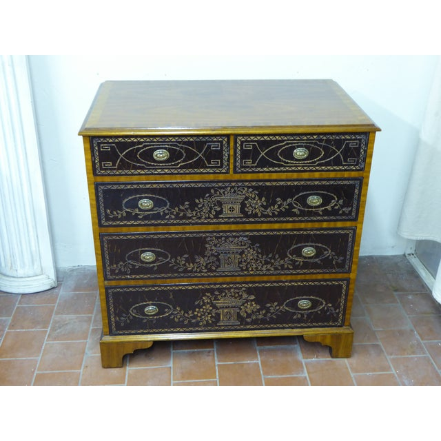 Maitland Smith mahogany and leather clad chest of drawers with identifying label in top right hand drawer, bracket feet.