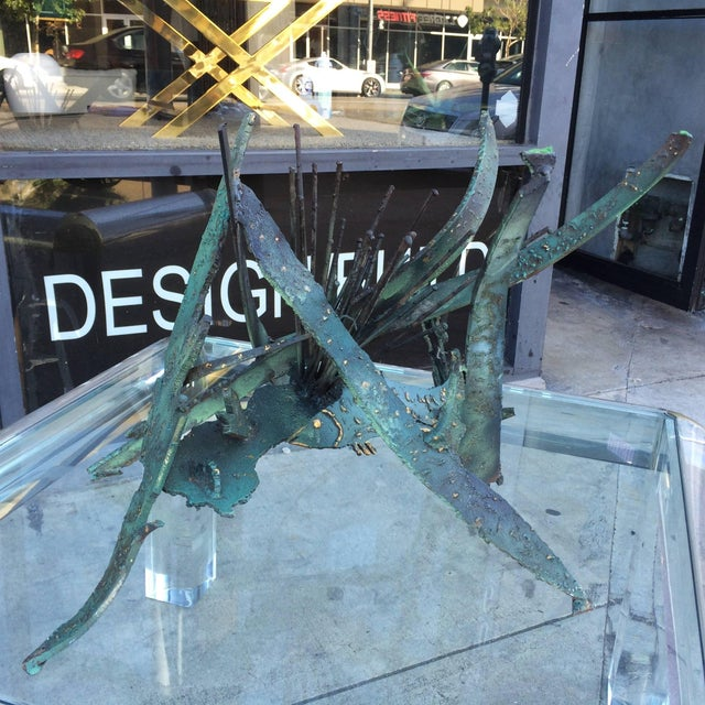 This sculpture is truly stunning, the piece is well made and in very good condition, the piece appears to depict a sea...