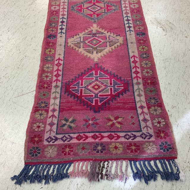 2'7 x 13' Vintage rug from turkey. Hand vegetable dyed and hand knotted. Bright hot pink purples and blues throughout-...