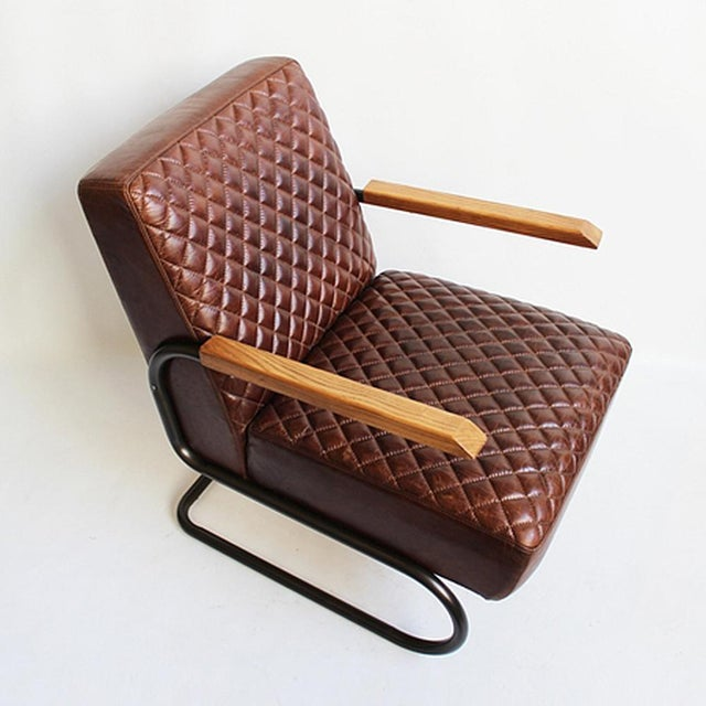 Offered is a vintage chestnut leather pillow quilted arm chair with smooth polished arms and gun metal base. A great...