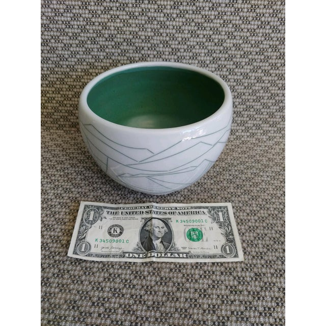 """A hand thrown porcelain bowl with modernist linear design, green on white, by Daric Harvie. 6"""" diameter."""