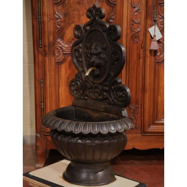 Bring the elegance of the Loire Valley into your home with this antique, Gothic iron fountain. Crafted circa 1840, the...
