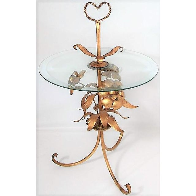 """Italian metal tole table with floral design. Glass top with rope heart at top. Dimensions: 32"""" x 18"""" x 18"""""""
