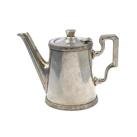 Vintage Orient Express silver-plate coffee pot once used in the railroad dining car of the legendary train. The authentic...