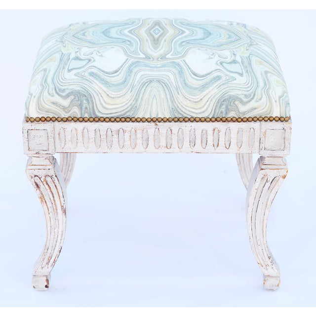 Bench, having a stuff-over seat with nailheads, on painted frame, showing natural wear to finish, its fluted apron,...