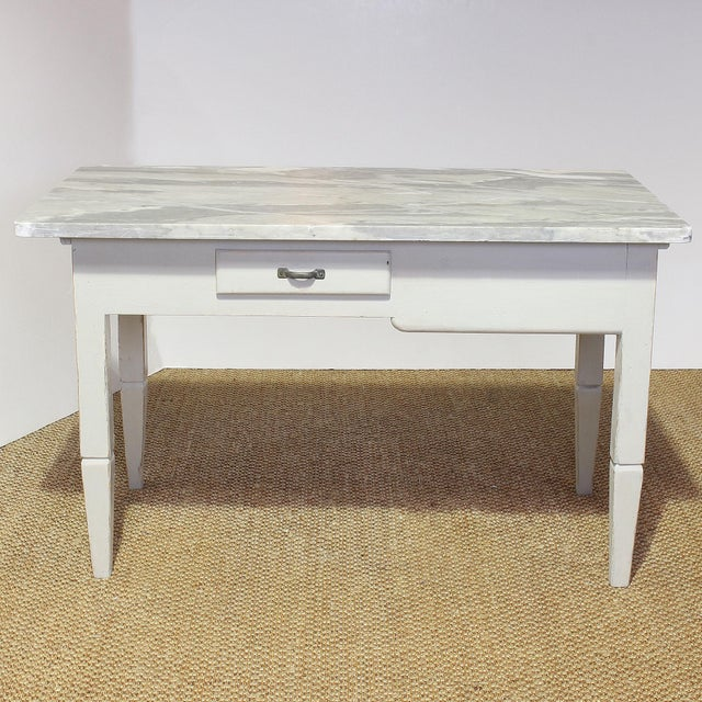 Vintage painted Italian baker's or kitchen worktable with a substantial and strikingly beautiful marble top. This table...