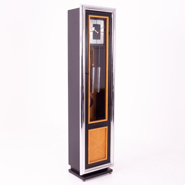 George Nelson for Howard Miller Mid Century Black and Chrome Grandfather Clock When you purchase a piece we carefully...
