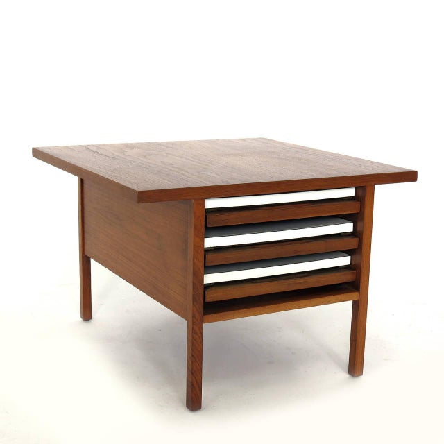 A unique, John Keal for Brown Saltman walnut table with three folding tables that slide inside. The side tables are walnut...