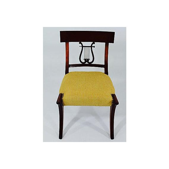 Klismos chair turn of the century in solid mahogany beautifully carved great condition all original finish, fabric is new....