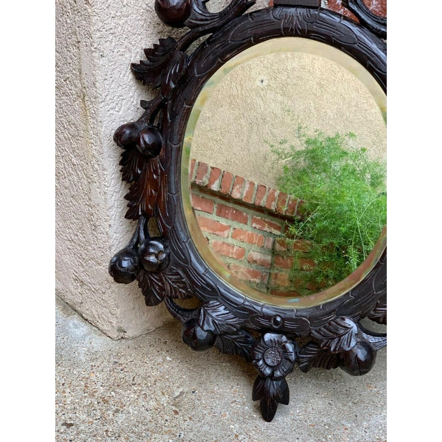 Wood 19th Century Antique English Black Forest Style Carved Dark Oak Oval Wall Mirror For Sale - Image 7 of 13