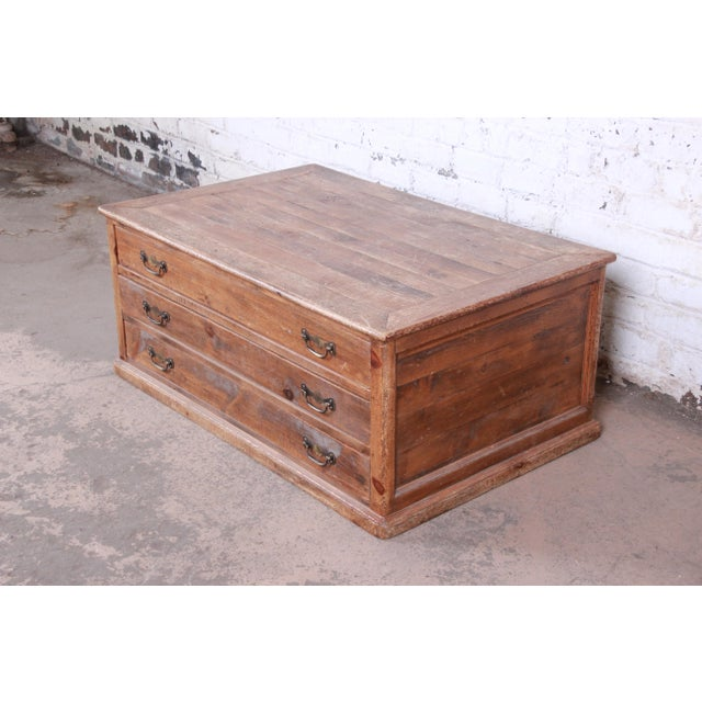 A rare and exceptional Country French primitive pine double-sided three-drawer map or flat file cabinet--perfect for a...
