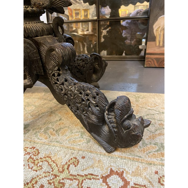 This is a gorgeous Burmese table. It features hand carved dragon feet and tropical hardware. The detailing from the hand...