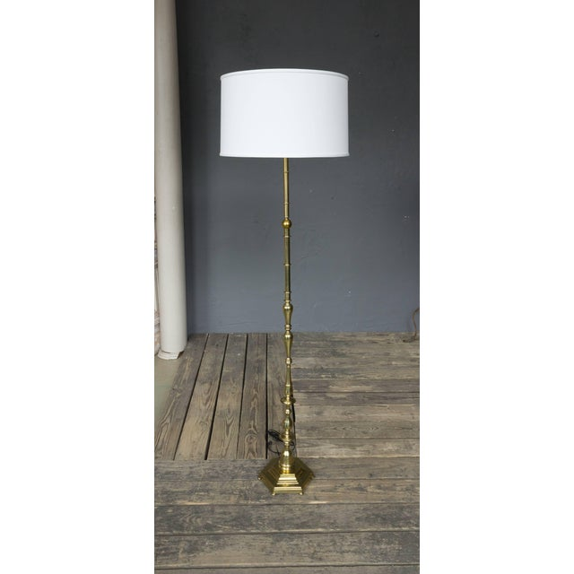 1940s French brass floor lamp on hexagonal base. Price includes polishing or plating and new wiring. Please allow 2 to 3...