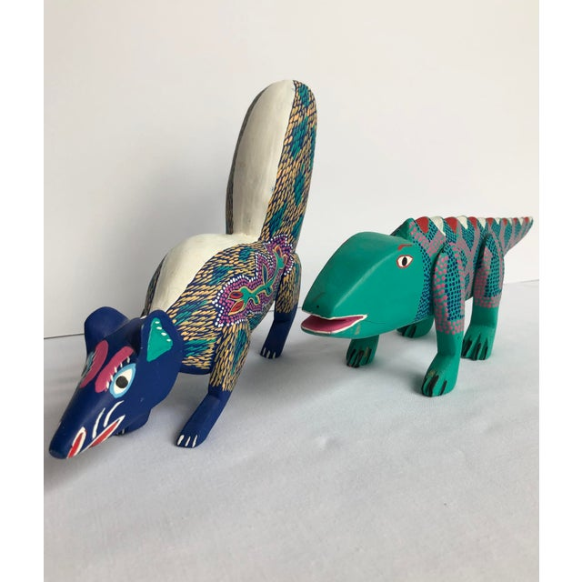 Vintage Mexican hand painted folk art lizard and skunk. Unmarked. These Oaxacan alebrijes were hand carved and hand...