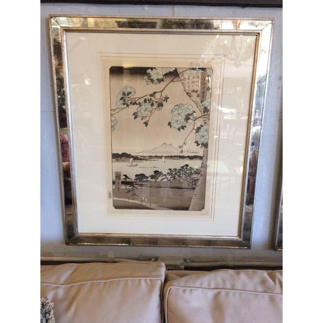 A pair of beautiful muted Asian prints double matted and framed in glamorous aged mirror moldings. From Trowbridge and a...