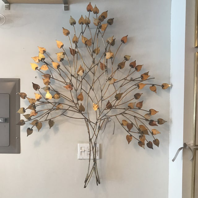 This is sure to warm up your space. Gorgeous hues of gold, silver, red and bronze. This is piece attaches to the wall with...