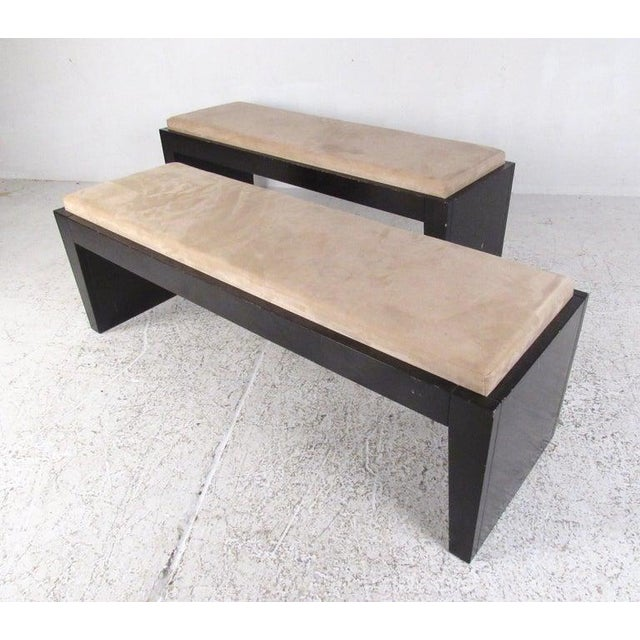 This stylish modern bench features comfortably upholstered seat and lacquered wood base. Perfect size for use at foot of...