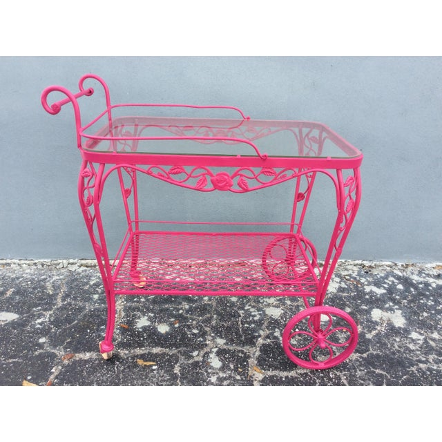 Vintage mid century wrought iron patio bar cart believed to be by Russell Woodard from the 1960's. This cart features...