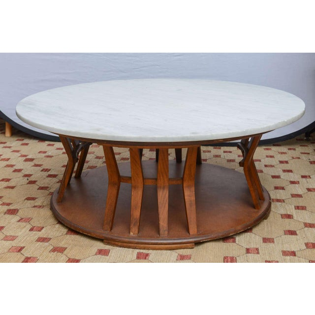 Beautiful marble-top coffee table in the Wormley for Dunbar style. Marble top has a repaired crack, 1960s, USA.