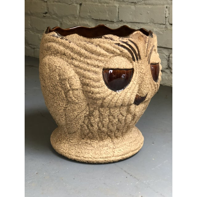 Charming midcentury ceramic planter with a stone like outer finish having figural owl details and cast feathers on all...