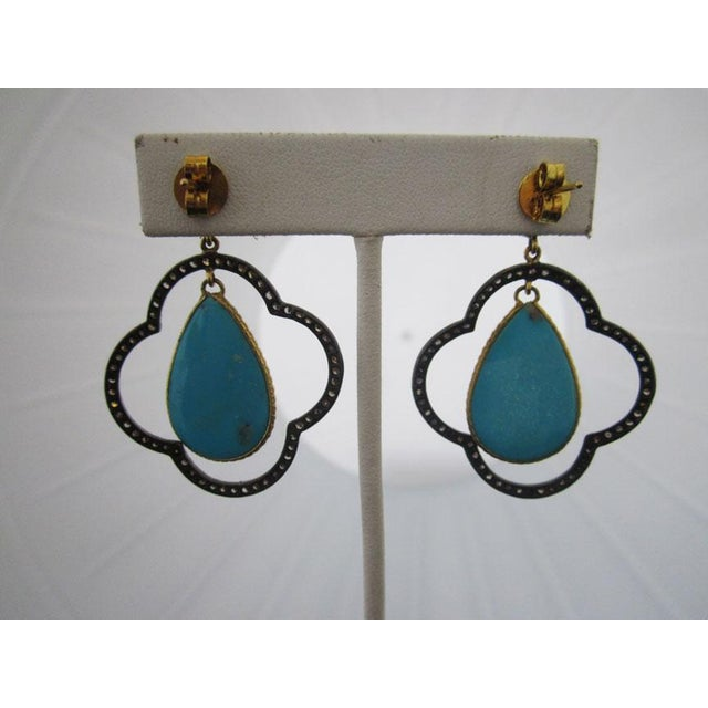 Black rhodium plated sterling silver earrings have a moroccan flare thanks to the open clover shape with micropave...