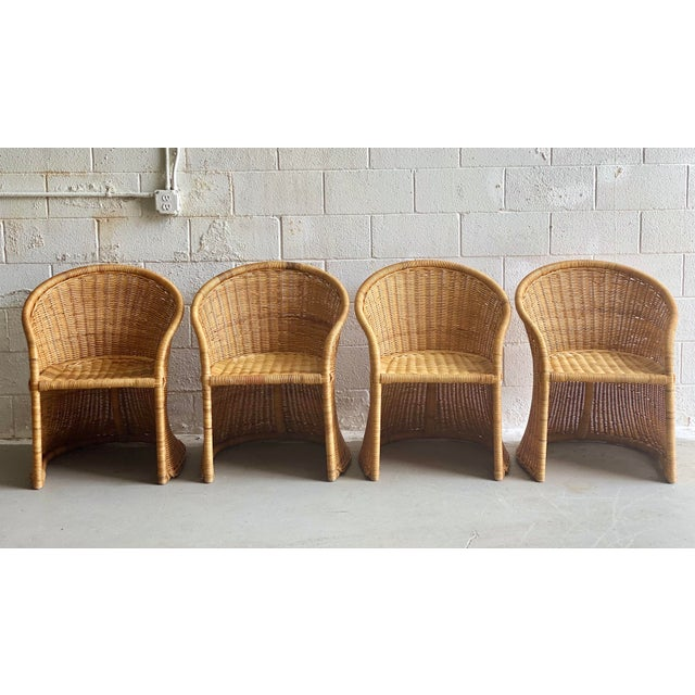 We are very pleased to offer an organic, sculptural set of four dining chairs and one dining table with a round thick...