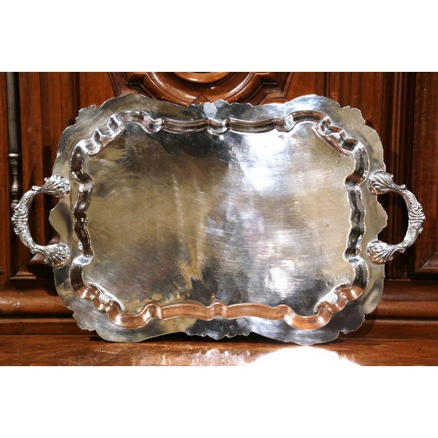 Elegant antique silver plated tray from France; crafted circa 1920, the decorative tray sits on four curved feet and...