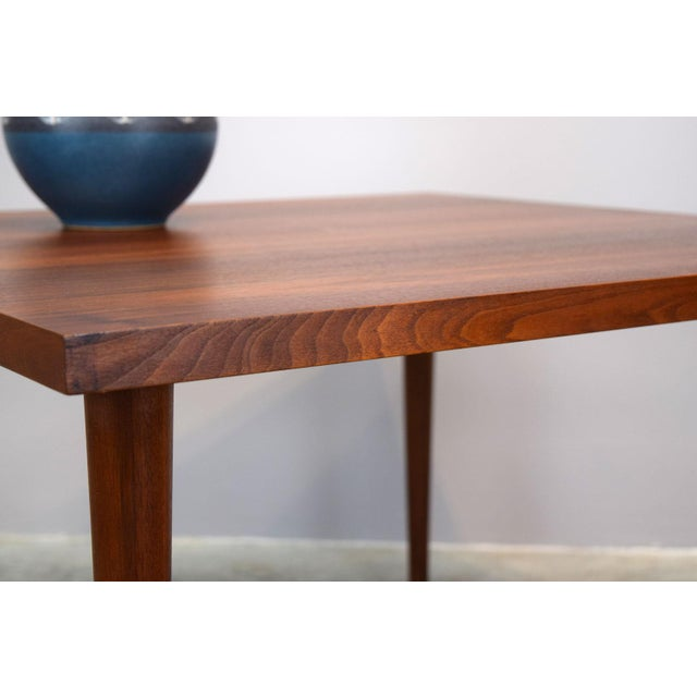 Nicely proportioned walnut square coffee, cocktail, side- or end-table with a gorgeous oiled finish made in the 1960s. It...
