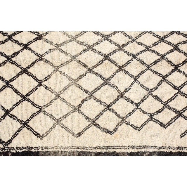 Vintage Moroccan rug, handcrafted by the Beni Ouarain tribes of Morocco. White lush organic natural wool, hand woven by...