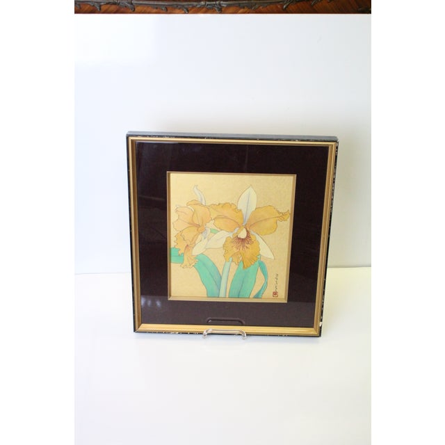 Delicate Asian print of yellow and white daffodils in gold and burgundy mat and black frame with glass.