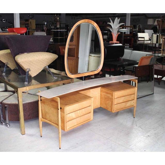 Beautiful curved shape Italian modern vanity with floating marble top.