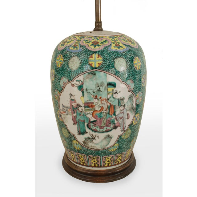 Pair of Asian Chinese style (19/20th Cent) ginger jar shaped green porcelain table lamps with scenes having figures on a...