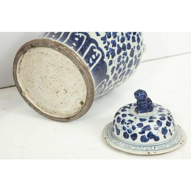 Blue and white will never go out of style. This pair of Chinese jars with lids feature a beautiful glaze with lovely...