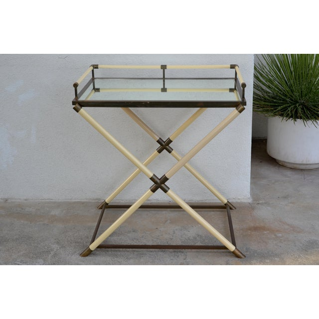 Chic mirrored and patinated brass bar cart by Maison Jansen. Attractive X stretcher design with removable tray for...