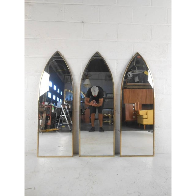 Three mid-century modern church style arch mirrors with brass frame, circa 1960s. Can be displayed together or separately....