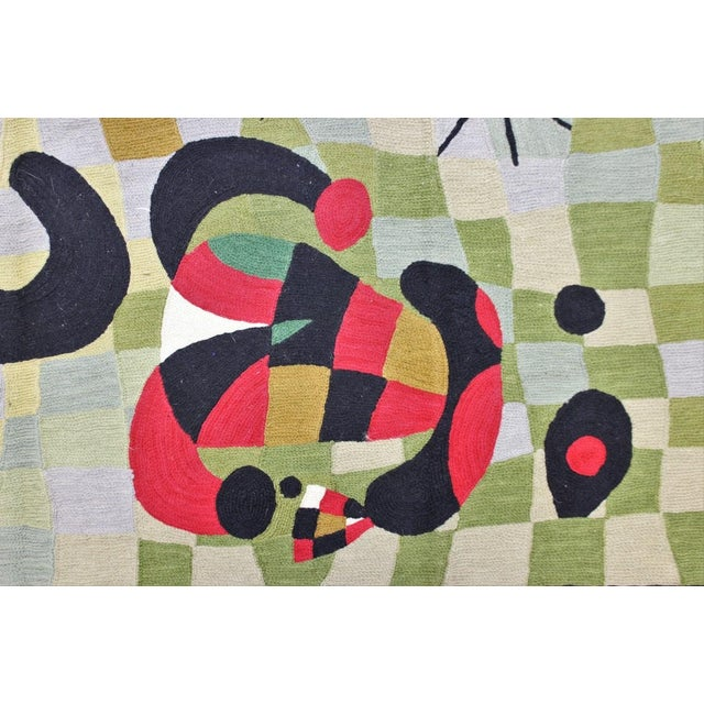 Hand-stitched wool abstract rug.