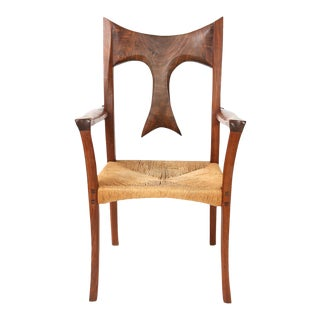 1970s Vintage Sculpted Walnut & Raffia Studio Walnut Arm Chair For Sale