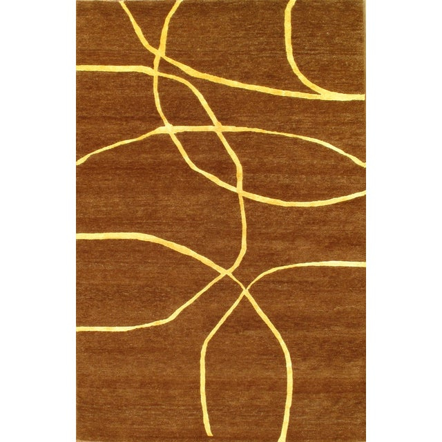 Hand-knotted lamb's wool rug from India. Very soft and comfortable rug.
