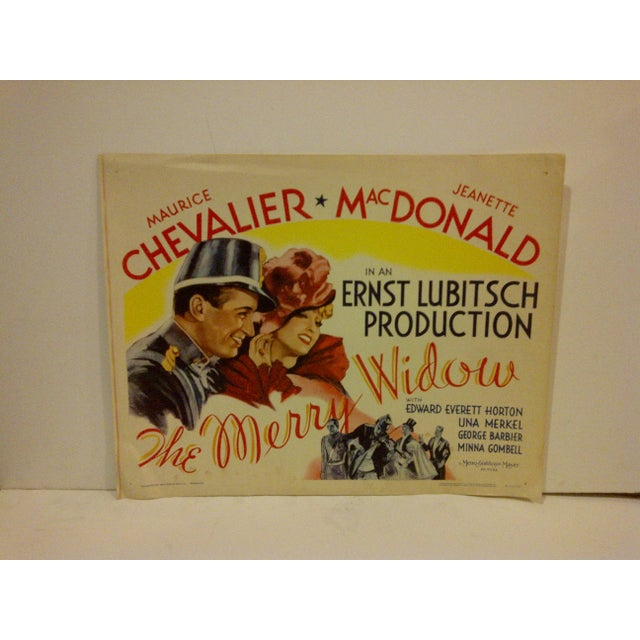 "A vintage movie poster, ""The Merry Widow"", starring Maurice Chevalier & Jeanette MacDonald, R62/198. Copyright 1962, Metro..."