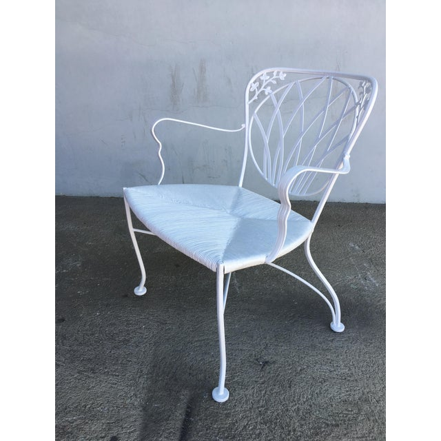 Woodard rod iron outdoor/patio chair with a distinct art nouveau backrest. This chair is constructed with solid core iron...