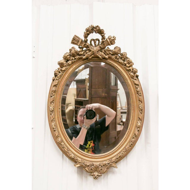 Gold 19th Century French Louis XVI Style Carved Oval Giltwood Mirror For Sale - Image 8 of 8