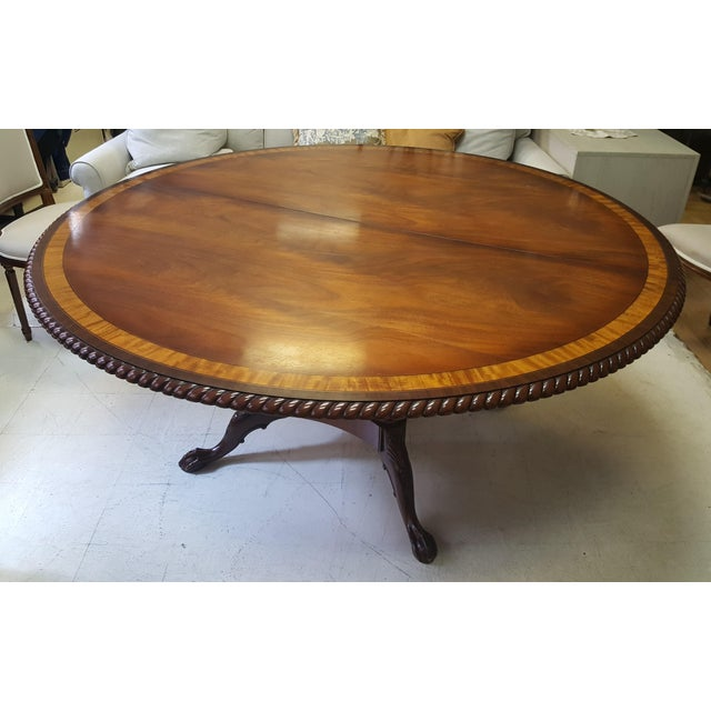 """This is a large 64"""" diameter table with 1 22"""" leaf. Open to 86"""". This piece is a showroom sample. Is has been used in our..."""