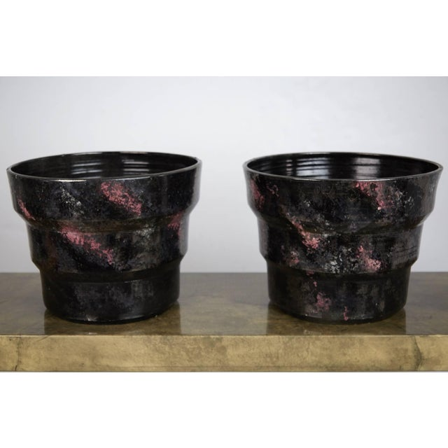 Invest in a piece of design history with this pair of signed fiberglass with hand-painted glaze planters by Gary McCloy...