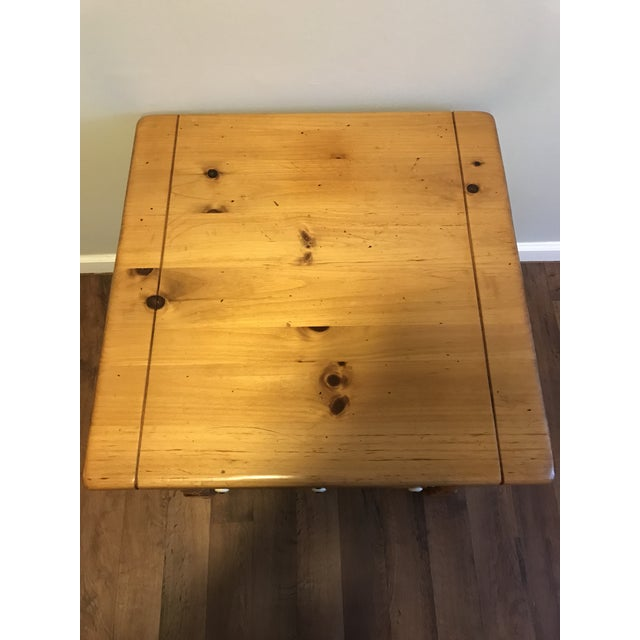 Offering an Ethan Allen antiqued pine end table. It does have some small knicks on the corner