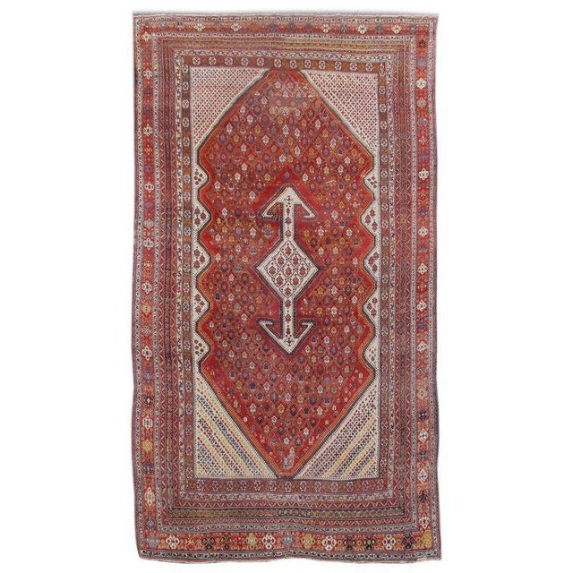 This Bakhtiari carpet, from the Chahar Mahal region of central west Persia, combines a princely size with a cheerful...